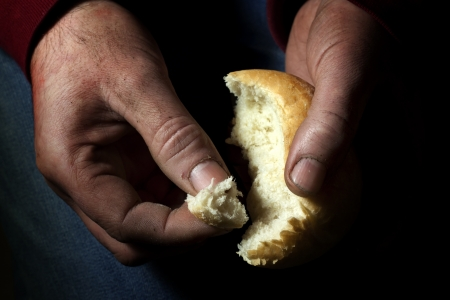 poverty, hands with bread photo