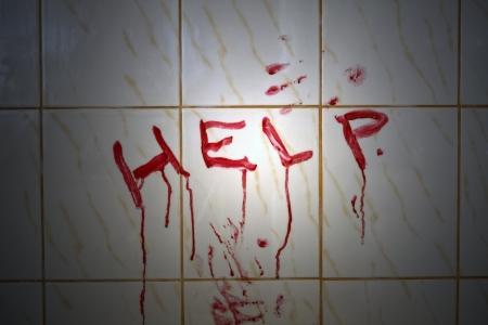 Help bloody inscription in the bathroom  Standard-Bild