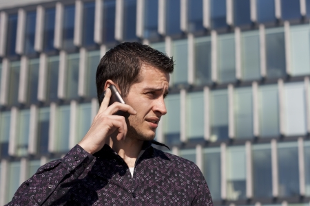 Young man using mobile phone photo