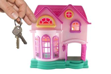 key to own home abstract concept with toy home photo