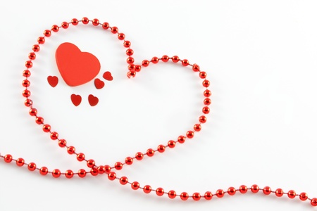 christmas beads:  Valentines abstract hearts shape with corals on white