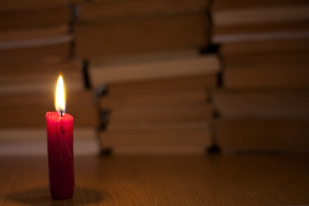 old books and candle light abstract background Stock Photo - 14162096