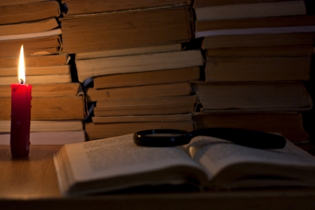 ancient books:  old books and candle light abstract background
