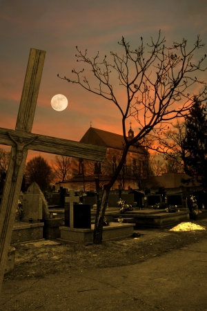 cemetery in night church and cross photo