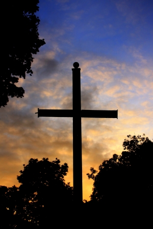 cross and sunset at cemetery photo