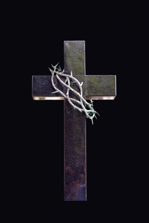 cross and thorns isolated in black photo