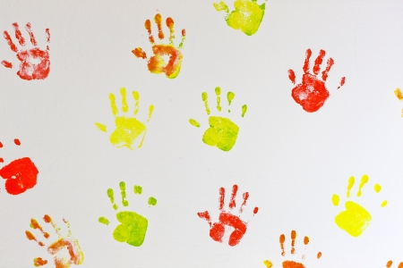 Kids hands prints on the wall background photo