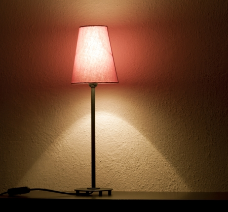 Lamp on the shelf in night abstract background photo