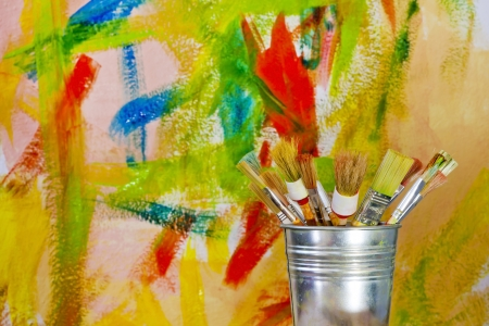 painting wall and brushes abstract concept Stock Photo
