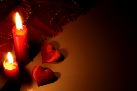 flame like:  red candles and hearts abstracy background in night Stock Photo