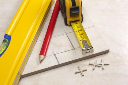 tiler:  tiler, tiles and planning work Stock Photo