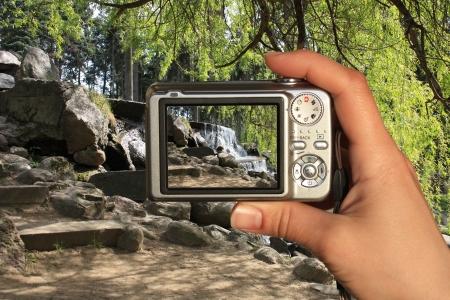 photographer takes photo of waterfall photo