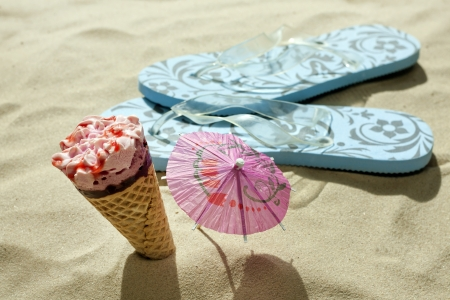 hot day:  ice cream on beach and sandals holiday hot days concept Stock Photo