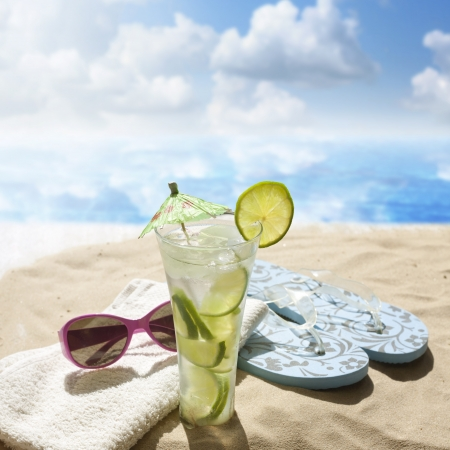 shades:  sunglasses drink in sand on beach at sea holiday concept
