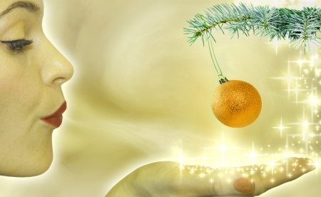 Christmas concept with woman blowing to bauble Stock Photo - 14349645