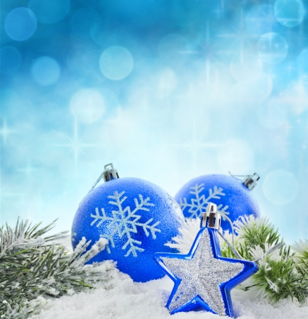 Christmas branch of tree blue baubles and snow background Stock Photo - 14349620