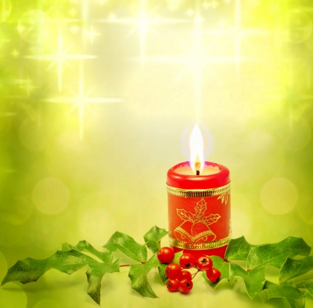 Christmas candle and holly background concept photo
