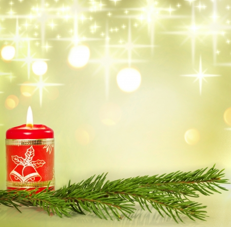 mood: Christmas candle and holly background concept