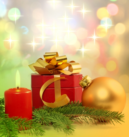 Christmas candle gift and bauble background photo