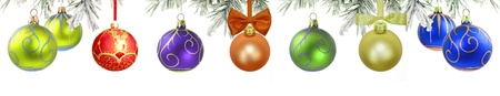 Christmas banner with green tree and baubles isolated photo