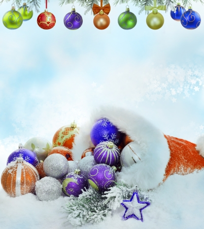 balls decorated:  Christmas santa claus hat baubles and snow concept Stock Photo