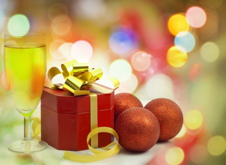 Christmas red gift and baubles on colorful background Stock Photo - 14349683
