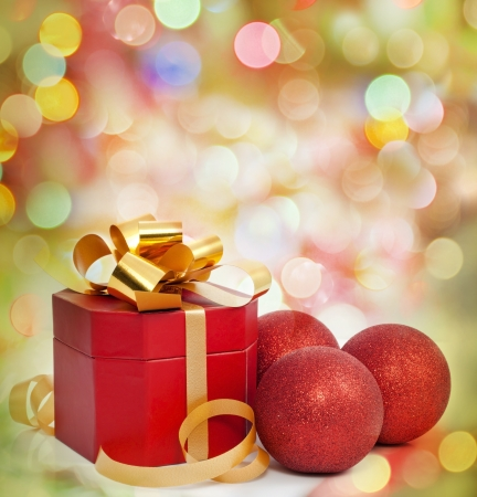 christmas bulbs:  Christmas red gift and baubles on colorful background