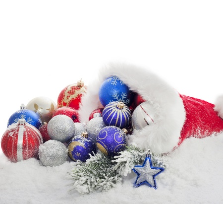 many christmas baubles:  Christmas baubles and gift in santa claus hat Stock Photo