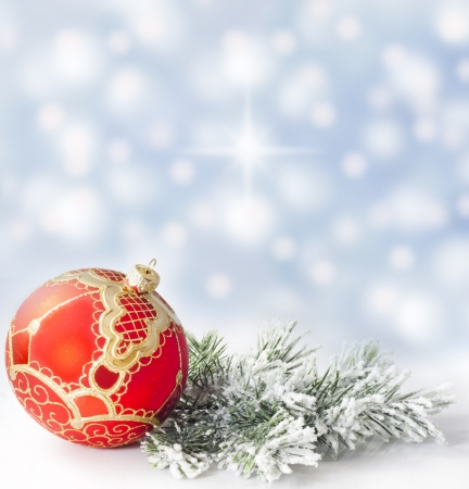 Christmas branch of tree red bauble snow background photo