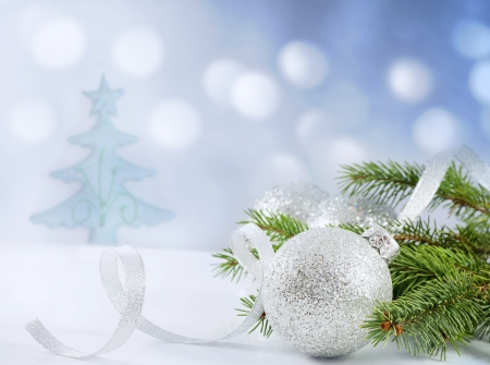 free christmas background:  Christmas branch of tree ribbon and bauble against snow