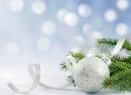 Christmas branch of tree ribbon and bauble against snow photo