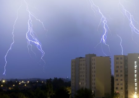 lightning in the sky in the city weather anomaly disaster Stock Photo