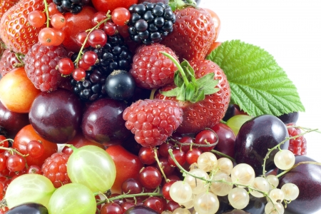 assortment of fresh berries and fruit background  photo