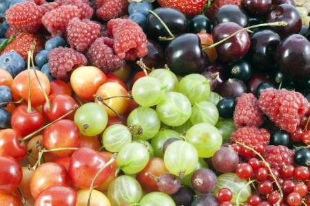 cherry varieties: assortment of fresh berries and fruit background  Stock Photo