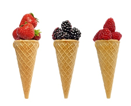 waffles:  ice cream waffle cone with berries fruits concept isolated