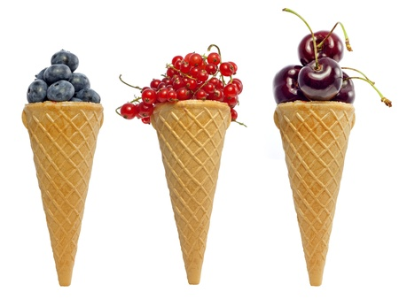 ice cream waffle cone with berries fruits concept isolated photo