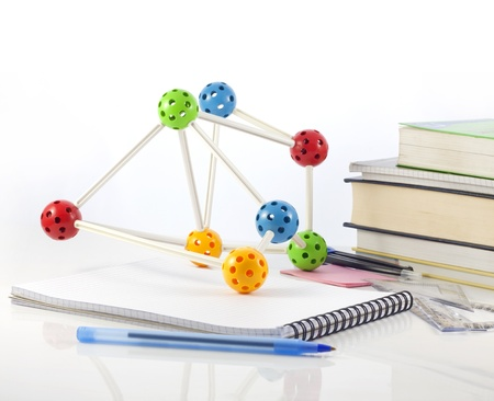 Science and education with books and molecule concept photo