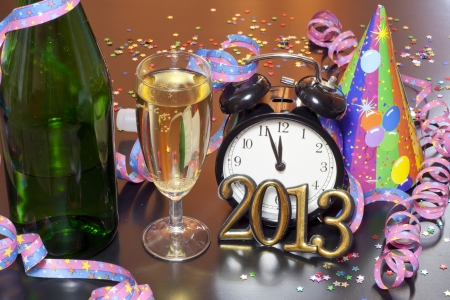 2013 happy new year party with champagne and clock