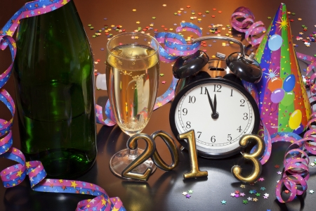 2013 happy new year party with champagne and clock  photo