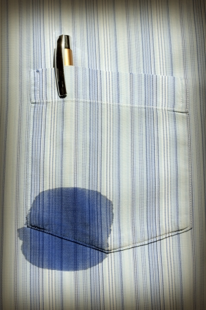 abstract of old technology with spot on the shirt with pen photo
