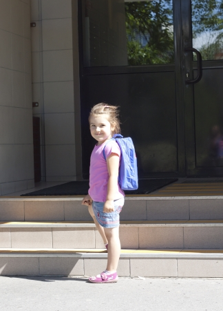 day of school:  First day of school and happy young girl