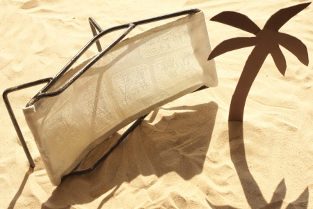 malcontent:  bad holiday and knocked deckchairs on the beach concept Stock Photo