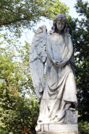 headstones:  Sculpture of angel on cemetery in Warsaw Stock Photo