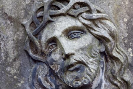 the crucifixion:  Closeup of Jesus Christ on old grunge grave Stock Photo