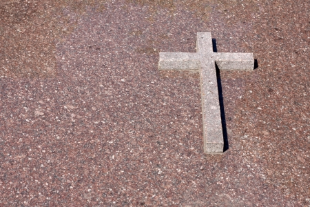 Cross on the marble wall background photo