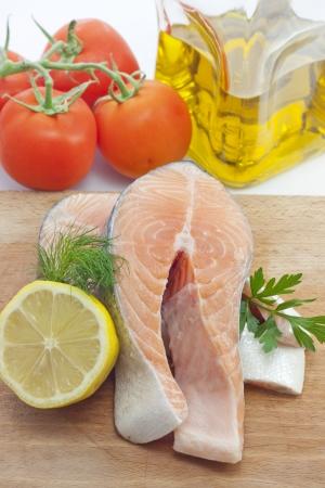 Raw salmon steak closeup in the kitchen photo