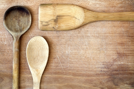 worse:  Old grunge wooden cutting kitchen desk board with spoon Stock Photo