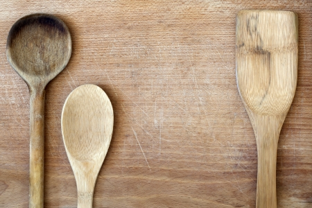 Old grunge wooden cutting kitchen desk board with spoon Stock Photo