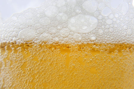 Beer macro foam and bubbles background photo