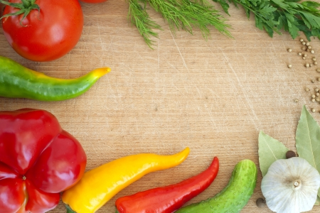 vegetables and spices border and empty cutting board Stock Photo - 14901106